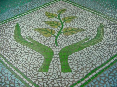 Trafford Macmillan Care Centre mosaic created by Sue Kershaw and clients of the centre where the mosaic is displayed