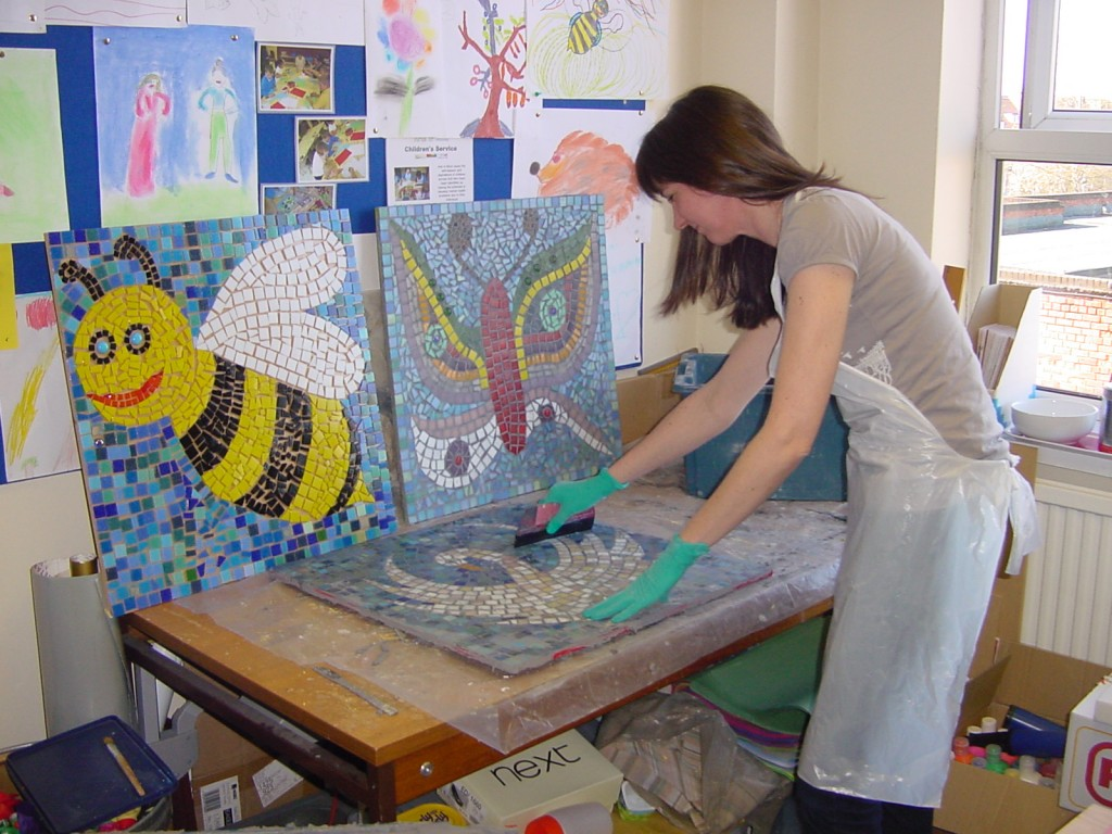 Sue Kershaw, Mosaic Artist grouting children's mosaics